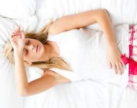 Чому болить живіт при вагітності? фото